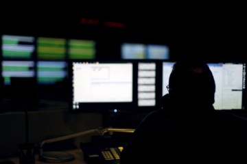 Image: File photo of a cybersecurity expert monitoring telecommunications traffic at a network operations center in a Verizon facility in Ashburn
