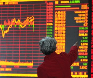 Investors observe stock market at a security trading floor on February 25, 2015 in Shenyang, Liaoning province of China. Source: ChinaFotoPress/Getty Images