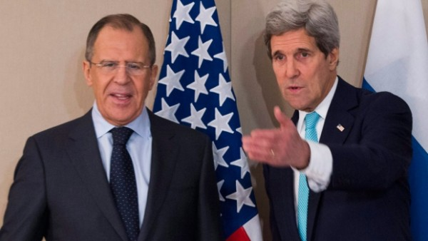 U.S. Secretary of State John Kerry, right, meets with Russian Foreign Minister Sergey Lavrov in Geneva, on March 2, 2015. (AP / Evan Vucci)