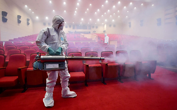 TOPSHOTS South Korean health officials fumigate a theater while wearing protective gear in Seoul on June 12, 2015. South Korea on June 12, reported four more cases of Middle East Respiratory Syndrome (MERS), bringing to 126 the total number of people diagnosed with the potentially deadly virus. AFP PHOTO / JUNG YEON-JEJUNG YEON-JE/AFP/Getty Images