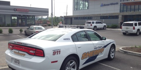 A Knox County Sheriff's Office cruiser is parked at the SmartBank Tuesday, July 7, 2015, off Cedar Bluff Road. Authorities are investigating the kidnapping of the bank manager and his family in connection with a robbery at the bank.  (ADAM LAU/NEWS SENTINEL)