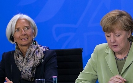 Christine Lagarde, managing director of International Monetary Fund (IMF), left, listens as Angela Merkel, Germany's chancellor, speaks during a news conference at the Chancellery in Berlin, Germany, on Tuesday, May 13, 2014. Merkel dismissed separatist referendums in Ukraine and called on all groups in the former Soviet republic and Russia to ensure that the presidential election scheduled for May 25 takes place. Photographer: Krisztian Bocsi/Bloomberg *** Local Caption *** Christine Lagarde; Angela Merkel