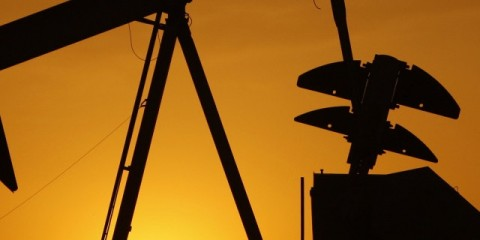 FILE- In this Tuesday, March 22, 2012 file photo, a pump jack is silhouetted against the setting sun in Oklahoma City. Declining oil prices could cost Oklahoma residents an income tax cut in 2016. A law signed in April by Gov. Mary Fallin requires an increase in state revenue, provided in part by tax collections that rise and fall with oil prices. (AP Photo/Sue Ogrocki, File) ORG XMIT: PXJE602