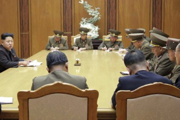 North Korean leader Kim Jong Un (2nd L) speaks at an emergency meeting of the Workers' Party of Korea (WPK) Central Military Commission, in this undated photo released by North Korea's Korean Central News Agency (KCNA) in Pyongyang on August 21, 2015. North Korean leader Kim Jong Un ordered his troops onto a war footing from 5 p.m on Friday after Pyongyang issued an ultimatum to Seoul to halt anti-North propaganda broadcasts by Saturday afternoon or face military action.   REUTERS/KCNA          ATTENTION EDITORS - THIS PICTURE WAS PROVIDED BY A THIRD PARTY. REUTERS IS UNABLE TO INDEPENDENTLY VERIFY THE AUTHENTICITY, CONTENT, LOCATION OR DATE OF THIS IMAGE. NO THIRD PARTY SALES. NOT FOR USE BY REUTERS THIRD PARTY DISTRIBUTORS. FOR EDITORIAL USE ONLY. NOT FOR SALE FOR MARKETING OR ADVERTISING CAMPAIGNS. SOUTH KOREA OUT. NO COMMERCIAL OR EDITORIAL SALES IN SOUTH KOREA. THIS PICTURE IS DISTRIBUTED EXACTLY AS RECEIVED BY REUTERS, AS A SERVICE TO CLIENTS. - RTX1P0IL