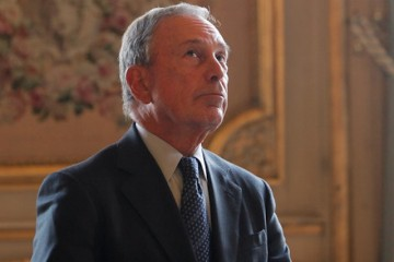 Former New York Mayor Michael Bloomberg looks up prior to being conferred with the Chevalier de la Legion d'Honneur by France's Foreign minister Laurent Fabius, at the Quai d'Orsay, in Paris, Tuesday, Sept. 16, 2014. (AP Photo/Thibault Camus)
