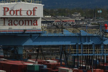 Crews work at the Port of Tacoma, which spans 2,725 acres, April 7, 2015. Together, the Port of Tacoma and the Port of Seattle are third largest container gateway in the United States.
