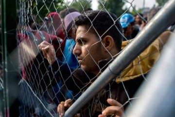 Migrants are seen at the closed Roszke-Horgos border crossing at the border between Hungary and Serbia, Tuesday, September 15, 2015. (Tamas Soki/MTI via AP) Migrants are seen at the closed Roszke-Horgos border crossing at the border between Hungary and Serbia, Tuesday, September 15, 2015. (Tamas Soki/MTI via AP)