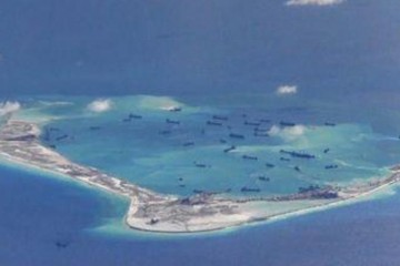 Chinese dredging vessels are purportedly seen in the waters around Mischief Reef in the disputed Spratly Islands in the South China Sea in this still image from video taken by a P-8A Poseidon surveillance aircraft provided by the United States Navy in this May 21, 2015 file photo. REUTERS/U.S. Navy/Handout via Reuters