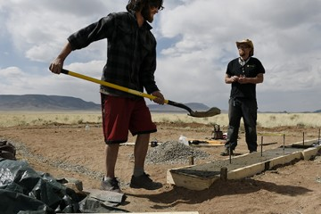 San Luis, CO. - APRIL 21: Sundance Stadtler, left, and his neighbor, Ryan McPherson, work on the foundation of the home Stadtler is building in the desert near San Luis, CO April 21, 2015. Stadtler moved to Costilla County, to grow his own marijuana on low-priced desert land. (Photo By Craig F. Walker / The Denver Post)