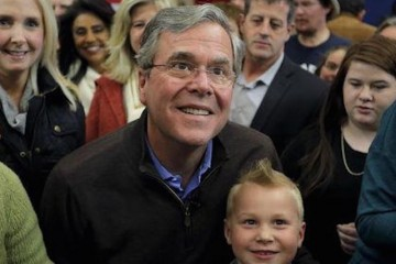 U.S. Republican presidential candidate Jeb Bush takes a picture with a young boy after speaking during a campaign event in Sumter, South Carolina February 11, 2016. REUTERS/Chris Keane