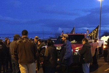 """In an event organized by the Pacific  Patriot's Network, more than a 100 people showed up Saturday evening at the start of a """"rolling rally"""" in Burns, Oregon that involved driving honking cars and trucks through the town. This was the first in what is expected to be a series of protests over the law enforcement shooting death last Tuesday of Robert """"LaVoy Finicum, a participant in the takeover of the Malheur National Wildlife Refuge that began Jan. 2, 2016. Date: January 30, 2015"""