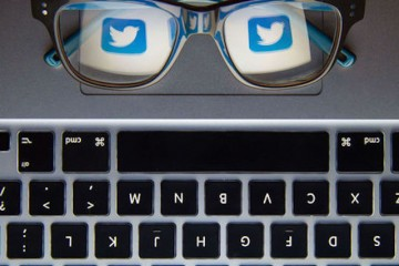 The logo of social network site Twitter reflected in a pair of glasses. PRESS ASSOCIATION Photo. Picture date: Monday November 30, 2015. Photo credit should read: Dominic Lipinski/PA Wire