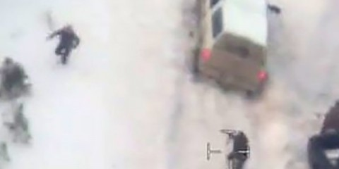 Aerial video released by the FBI January 28, 2016 shows a law enforcement officer (C) pointing a weapon at a man (L) who had just stepped out of the white pickup truck at a police roadblock January 26 near Burns, Oregon.  The FBI released video showing one of the men occupying an Oregon wildlife refuge reach for his jacket pocket before he was shot dead by law enforcement after speeding away from a traffic stop where the group's leader was arrested.  Authorities said 54-year-old Robert LaVoy Finicum, a rancher from Arizona who acted as a spokesman for the occupiers at the Malheur National Wildlife Refuge, was armed when he was stopped by police and killed on Tuesday afternoon.  REUTERS/FBI/Handout via Reuters   FOR EDITORIAL USE ONLY. NOT FOR SALE FOR MARKETING OR ADVERTISING CAMPAIGNS - RTX24HO9