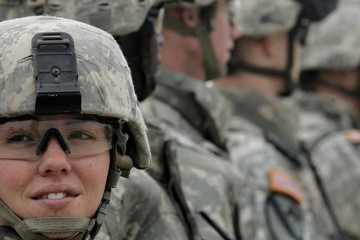 U.S. Specialist Jennifer Fifield of the 2nd Battalion of the 12th Cavalry Regiment attends a briefing at the forward operating base of Liberty camp April 1, 2007, before leaving for a mission in Baghdad's northwest Sunni neighborhood of Ghazaliya. REUTERS/Fabrizio Bensch (IRAQ) - RTR1O6I2