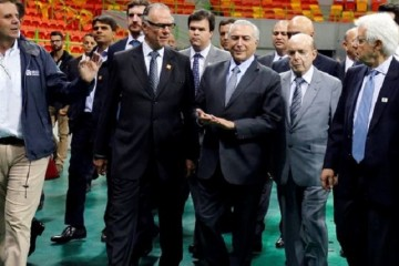 Brazil's interim President Michel Temer (3rd R) walks with Carlos Nuzman (2nd L), president of the Rio 2016 Organizing Committee Rio de Janeiro, City Mayor Eduardo Paes (L) and Rio de Janeiro interim governor Francisco Dornelles (2nd R) during a visit to the Olympic Park in Rio de Janeiro, Brazil June 14, 2016. REUTERS/Sergio Moraes
