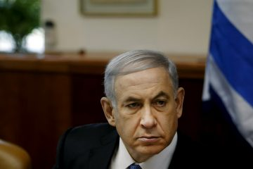 "Israel's Prime Minister Benjamin Netanyahu chairs the weekly cabinet meeting in Jerusalem, Sunday, Nov. 30, 2014. Israel's prime minister said Sunday that the public expects the government to ""return to normal conduct"" and hinted at the possibility of early elections if his coalition does not overcome a crisis linked to a contentious nationality bill that would enshrine Israel's status as a Jewish state. The proposal would also make Jewish law a source of legislative inspiration and delist Arabic as an official language. (AP Photo/Ronen Zvulun, Pool)"