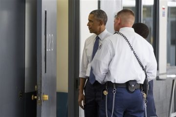 President Barack Obama looks inside a cell as he is led on a tour by Bureau of Prisons Director Charles Samuels, right, and correctional officer Ronald Warlick during a visit to the El Reno Federal Correctional Institution in El Reno, Okla., Thursday, July 16, 2015. As part of a weeklong focus on inequities in the criminal justice system, the president will meet separately Thursday with law enforcement officials and nonviolent drug offenders who are paying their debt to society at the El Reno Federal Correctional Institution, a medium-security prison for male offenders near Oklahoma City. (AP Photo/Evan Vucci)