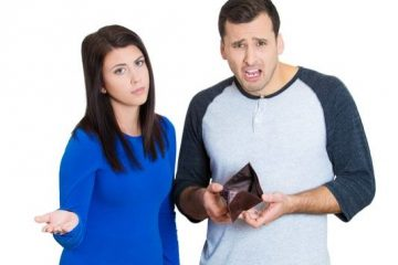 young-couple-with-no-money-empty-wallet-getty_large
