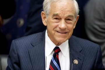 U.S. Representative Ron Paul, a Republican from Texas, waits for the start of a House Financial Services Committee hearing on the semiannual monetary report with Federal Reserve Chairman Ben S. Bernanke in Washington, D.C., U.S., on Wednesday, July 13, 2011. Bernanke told Congress the central bank is prepared to take additional action, including buying more government bonds, if the economy appears to be in danger of stalling. Photographer: Joshua Roberts/Bloomberg *** Local Caption *** Ron Paul