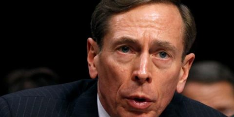 """FILE PHOTO - CIA Director David Petraeus speaks to members of a Senate (Select) Intelligence hearing on """"World Wide Threats"""" on Capitol Hill in Washington in this January 31, 2012 file photo.REUTERS/Kevin Lamarque/File Photo"""