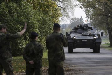 "German army soldiers in their infantry fighting vehicle, the ""Marder"", arrive for the NATO military drill in Adazi, Latvia, October 4, 2015. With signs growing of a thaw between Moscow and Western capitals after the Paris attacks, some of Russia's neighbours fear that European resolve to keep up economic sanctions and military pressure over the Ukraine crisis may be waning. Picture taken October 4, 2015. REUTERS/Ints Kalnins      TPX IMAGES OF THE DAY      - RTS7T8Y"