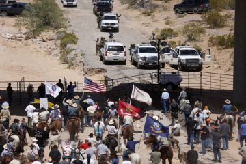 Protesters gather at the Bureau of Land Management's base camp, where cattle that were seized from rancher Cliven Bundy are being held, near Bunkerville, Nevada.