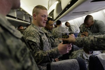 FORT HOOD, TEXAS - DECEMBER 16: U.S. Army soldiers from the 2-82 Field Artillery, 3rd Brigade, 1st Cavalry Division, drink an energy drink as they wait to disembark from their plane as they arrive at their home base of Fort Hood, Texas after being part of one of the last American combat units to exit from Iraq on December 16, 2011 in Fort Hood, Texas. The U.S. military formally ended its mission in Iraq after eight years of war and the overthrow of Saddam Hussein.  (Photo by Joe Raedle/Getty Images)