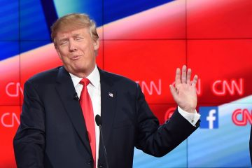 Republican presidential candidate, businessman Donald Trump, gestures during the Republican Presidential Debate, hosted by CNN, at The Venetian Las Vegas on December 15, 2015 in Las Vegas, Nevada. AFP PHOTO/ ROBYN BECK / AFP / ROBYN BECK        (Photo credit should read ROBYN BECK/AFP/Getty Images)