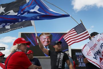 WEST PALM BEACH, FL - MARCH 04:  Richard Montero (C) shows his support for President Donald Trump near his Mar-a-Lago resort home on March 4, 2017 in West Palm Beach, Florida. President Trump spent part of the weekend at the house.  (Photo by Joe Raedle/Getty Images)