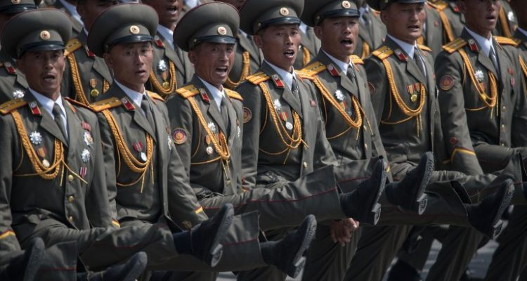 Korean People's Army (KPA) soldiers march during a military parade marking the 105th anniversary of the birth of late North Korean leader Kim Il-Sung in Pyongyang on April 15, 2017.  North Korean leader Kim Jong-Un on April 15 saluted as ranks of goose-stepping soldiers followed by tanks and other military hardware paraded in Pyongyang for a show of strength with tensions mounting over his nuclear ambitions. / AFP PHOTO / Ed JONES