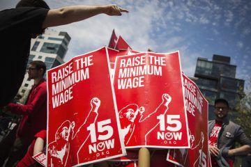 Demonstrators prepare signs supporting the raising of the federal minimum wage during May Day demonstrations in New York May 1, 2014. REUTERS/Lucas Jackson (UNITED STATES - Tags: CIVIL UNREST POLITICS BUSINESS EMPLOYMENT TPX IMAGES OF THE DAY) - RTR3NFQ0