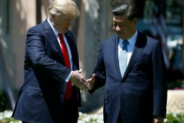 President Donald Trump and Chinese President Xi Jinping walk together at Mar-a-Lago, Friday, April 7, 2017, in Palm Beach, Fla. (AP Photo/AlexBrandon)