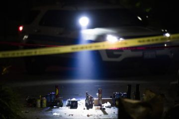 Police illuminate a pile of used fireworks at the scene where a person was shot near the intersection of West 105th Street and South Aberdeen Street Tuesday, July 4, 2017 in Chicago. (Armando L. Sanchez/Chicago Tribune/TNS)